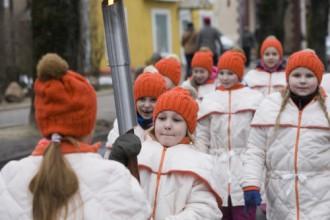 Siguldā iedegta Latvijas III ziemas olimpiādes lāpa