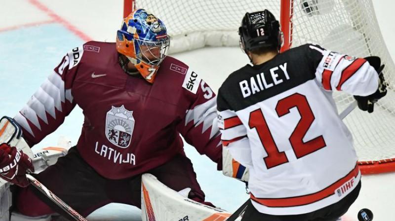 Kristers Gudļevskis un Džošua Beilijs Foto: AFP/Scanpix