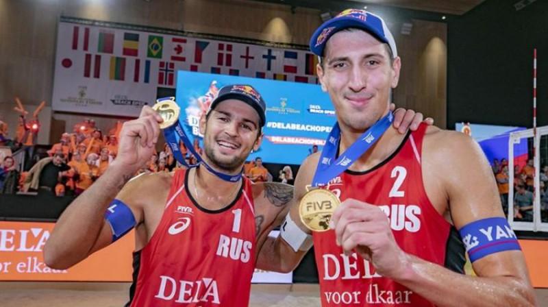 Vjačeslavs Krasiļņikovs un Oļegs Stojanovskis. Foto: FIVB