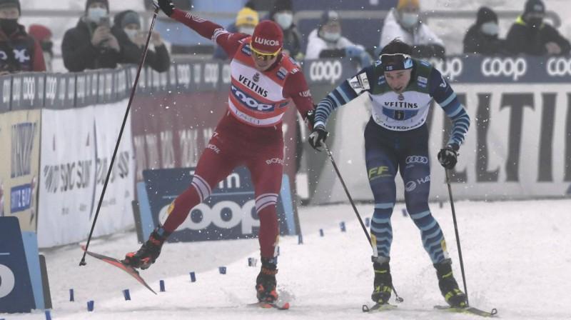 Aleksandrs Bolšunovs cīņā ar somu sportistu. Foto: Imago Images/Scanpix